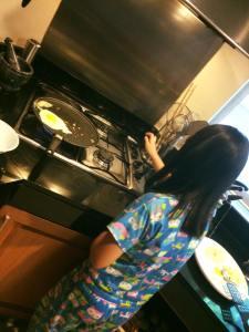 Catie making pancakes